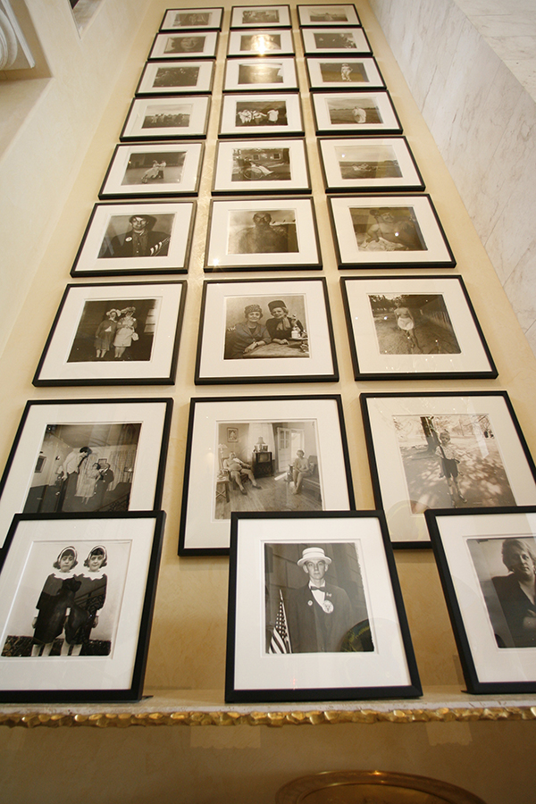 Leland's collection of 28 Diane Arbus photographs (1962-1971) along a 40 foot wall in his home.